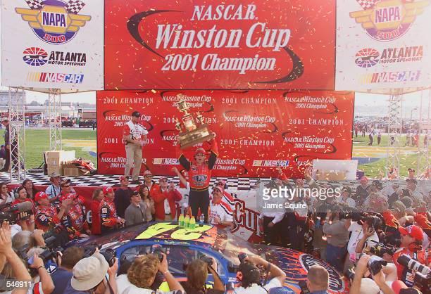 Jeff Gordon celebrates winning the championship at the NASCAR Winston Cup NAPA 500 at the Atlanta Motor Speedway in Hampton Georgia Digital Image...