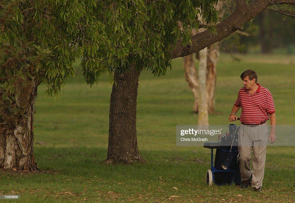 Jeff Kennett former Premier of Victoria searches for his ball on the 17th fairway during the Australian PGA Championship Pro AM held at Royal Queensland Golf Club, Brisbane, Australia. DIGITAL IMAGE Mandatory Credit: Chris McGrath/ALLSPORT