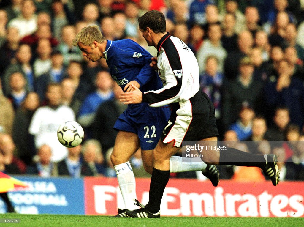 Jim Magilton of Ipswich Town tries to tackle Eidur Gudjohnsen of Chelsea during the FA Barclaycard Premiership match between Chelsea and Ipswich Town at Stamford Bridge, London. Mandatory Credit: Phil Cole/ALLSPORT