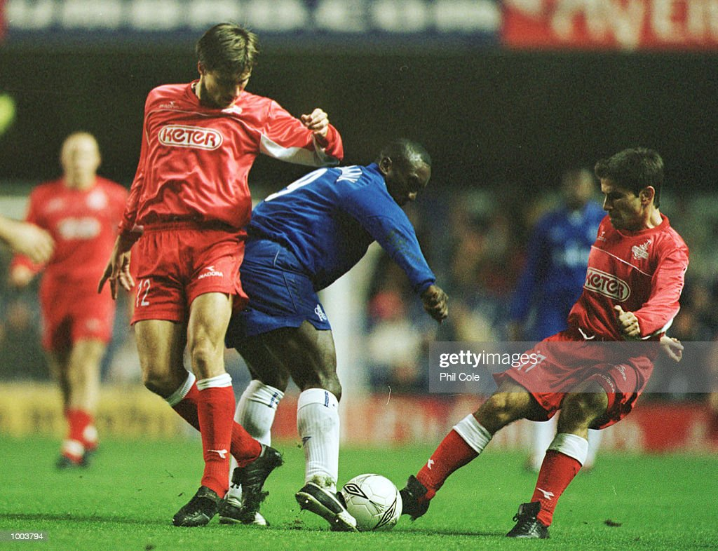 Jimmy Floyd Hasselbaink of Chelsea is tackled by Denys Onyschenko and Ben Luz of Tel-Aviv during the UEFA Cup 2nd round, 2nd leg match between Chelsea FC and Hapoel Tel-Aviv at Stamford Bridge, London. Mandatory Credit: Phil Cole/ALLSPORT