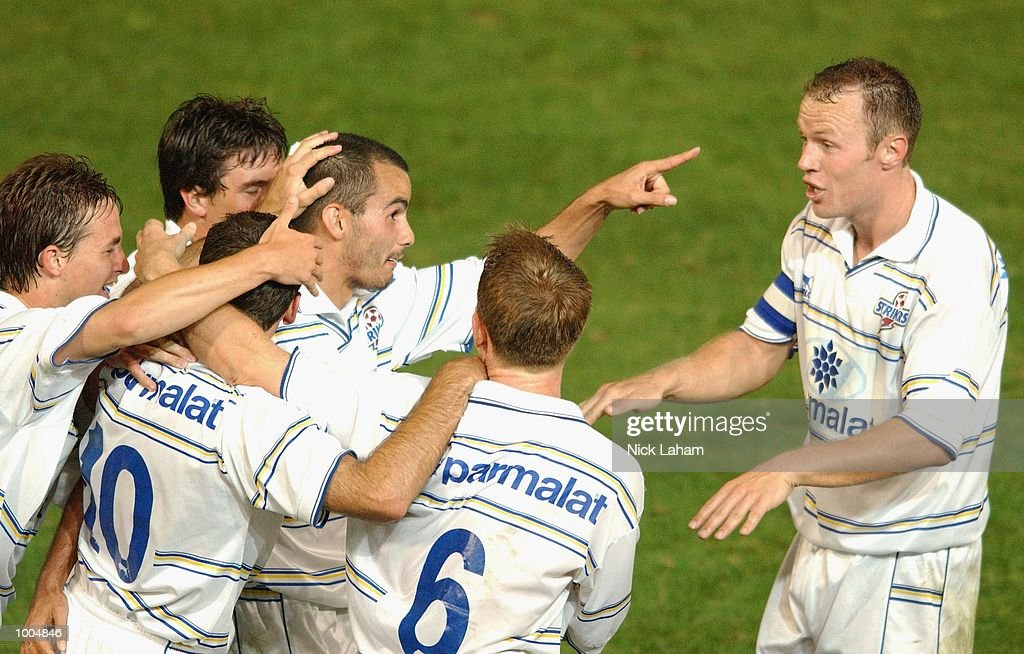 John Carbone #11 of the Strikers celebrates scoring the winning goal with his team mates during the NSL match between the Parramatta Power and the Brisbane Strikers held at Parramatta Stadium, Sytdney, Australia. Strikers 2 defeated the Power 1. DIGITAL IMAGE Mandatory Credit: Nick Laham/ALLSPORT