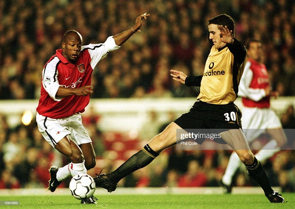 John O'' Shea of Manchester United tries to tackle Sylvain Wiltord of Arsenal during the Worthington Cup, Third Round match between Arsenal and Manchester United at Highbury, London. Mandatory Credit: Phil Cole/ALLSPORT