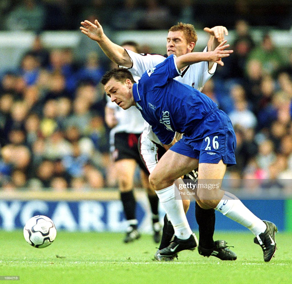 John Terry of Chelsea is tackled by Richard Naylor of Ipswich Town during the FA Barclaycard Premiership match between Chelsea and Ipswich Town at Stamford Bridge, London. Mandatory Credit: Phil Cole/ALLSPORT