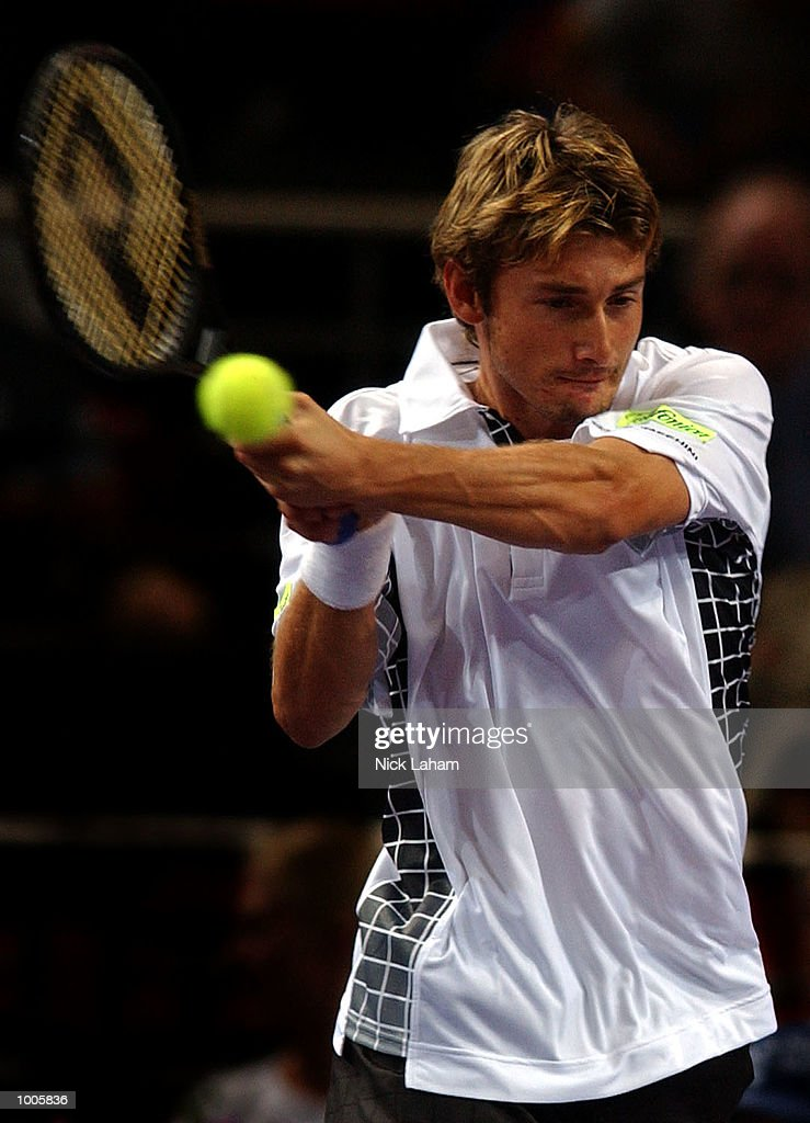 Juan Carlos Ferrero of Spain in action during his match against Gustavo Kuerten of Brazil during the Tennis Masters Cup held at the Sydney Superdome, Sydney, Australia. DIGITAL IMAGE Mandatory Credit: Nick Laham/ALLSPORT