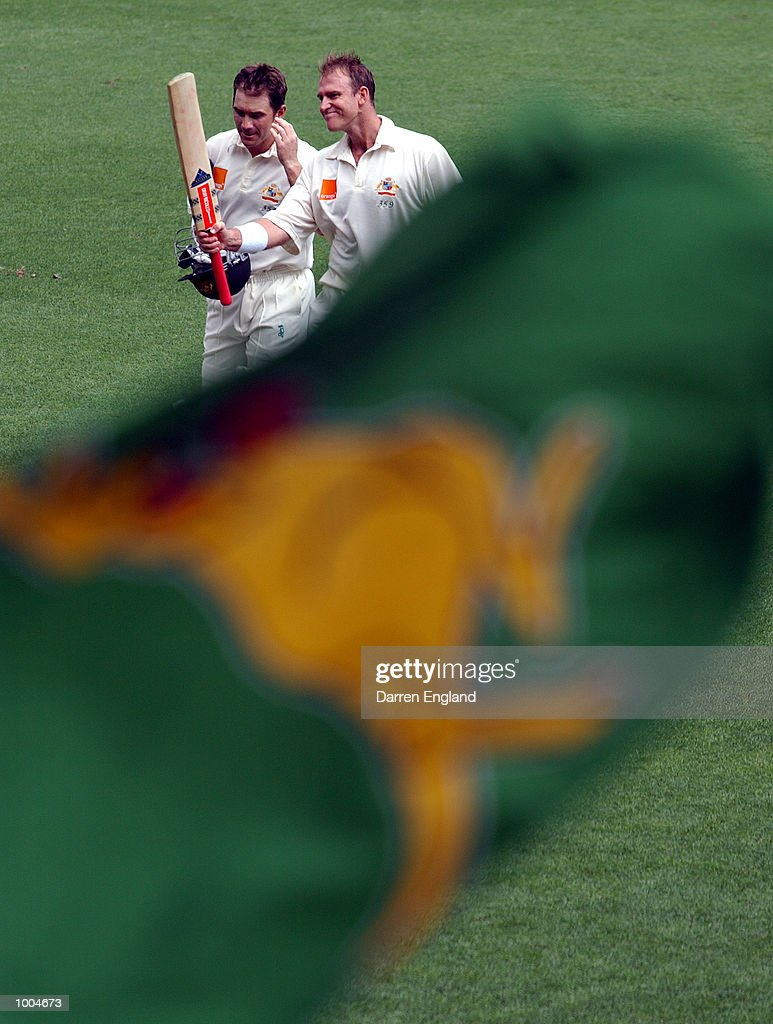 Justin Langer and Matthew Hayden of Australia acknowledge the crowd as they walk off the ground at tea time New Zealand during day one of the first Cricket test between Australia and New Zealand played at the Gabba in Brisbane, Australia.DIGITAL IMAGE. Mandatory Credit: Darren England/ALLSPORT