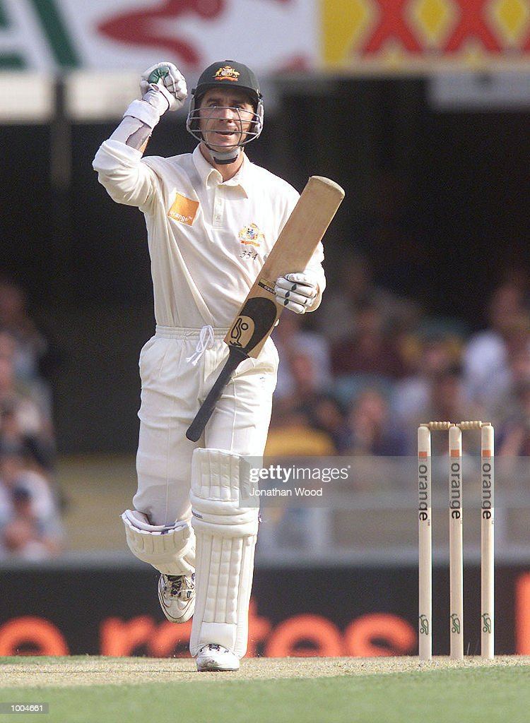 Justin Langer of Australia celebrates his century during the first day of the first Test between Australia and New Zealand played at the Gabba, Brisbane, Australia. DIGITAL IMAGE. Mandatory Credit: Jonathan Wood/ALLSPORT