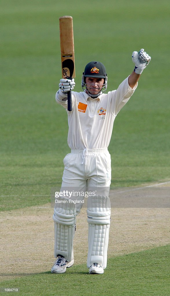 Justin Langer of Australia celebrates scoring a century against New Zealand during day one of the first Cricket test between Australia and New Zealand played at the Gabba in Brisbane, Australia. DIGITAL IMAGE. Mandatory Credit: Darren England/ALLSPORT