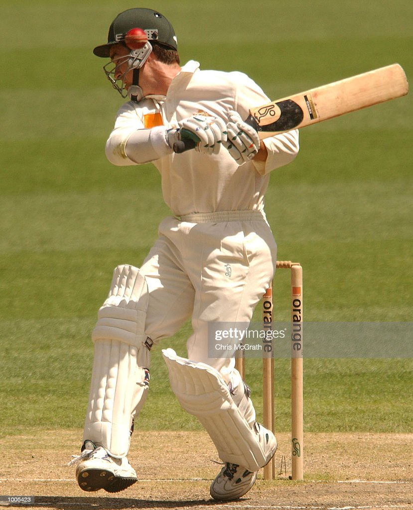 Justin Langer of Australia gets out of the way of a bouncer during day five of the first cricket test between Australia and New Zealand held at the Gabba, Brisbane, Australia, DIGITAL IMAGE Mandatory Credit: Chris McGrath/ALLSPORT