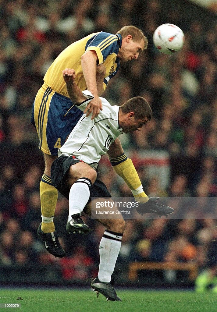 Kevin Phillips of England battles for the ball with Johan Mjallby of Sweden during the England v Sweden International friendly at Old Trafford, Manchester. Mandatory Credit: Laurence Griffiths/ALLSPORT