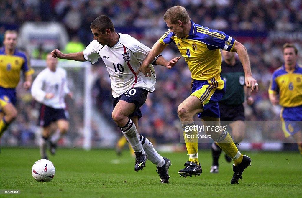 Kevin Phillips of England battles with Johan Mjallby of Sweden during the England v Sweden International friendly at Old Trafford, Manchester. DIGITAL IMAGE Mandatory Credit: Ross Kinnaird/ALLSPORT