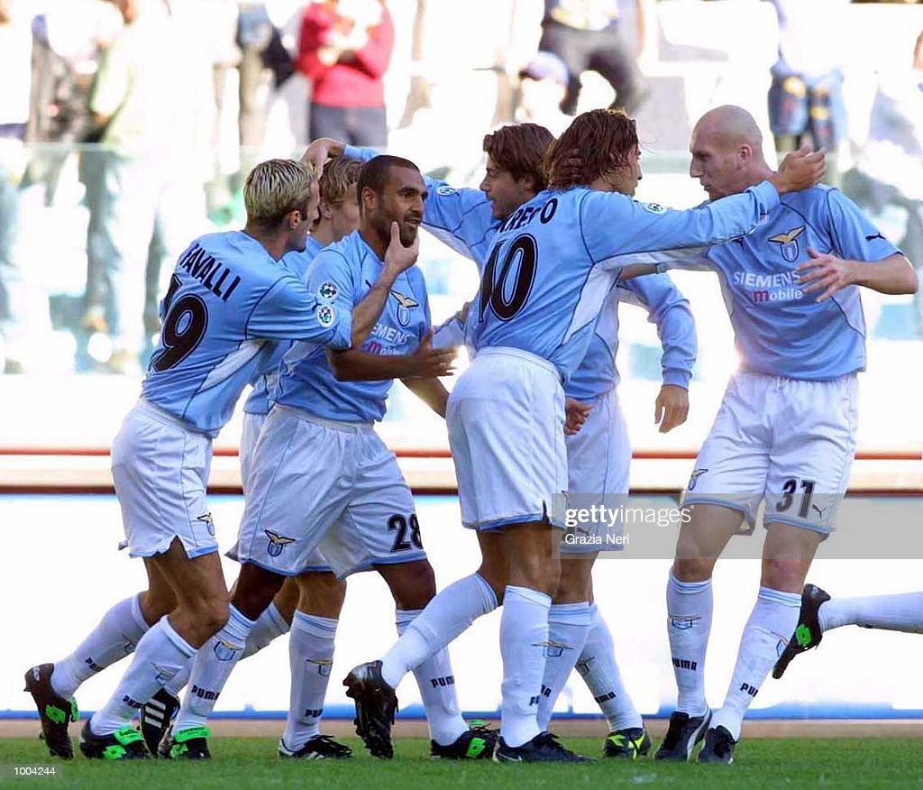 Lazio players celebrate a goal during the Serie A match between Lazio and Brescia, played at the Olympic Stadium, Rome. DIGITAL IMAGE Mandatory Credit: Grazia Neri/ALLSPORT