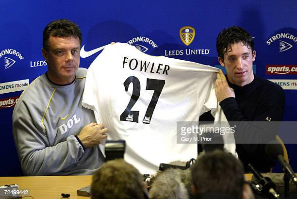Leeds United manager David O''Leary and Robbie Fowler hold up Fowler's new shirt at a press conference announcing Fowler's signing for Leeds United...
