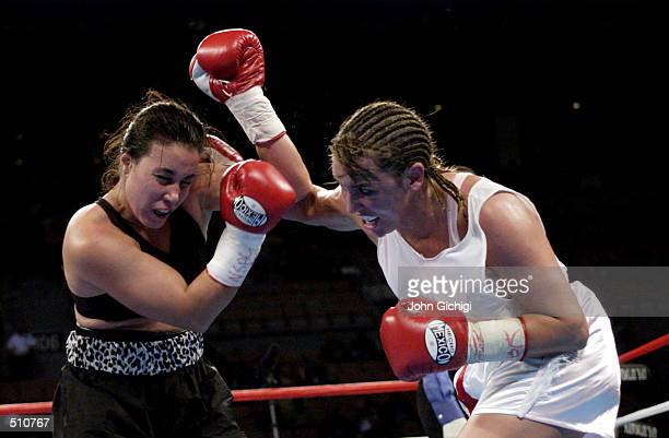 Lisa Holewyne and Christy Martin battle eachother during the women's pound for pound championship fight at the Mandalay Bay Resort Casino in Las...