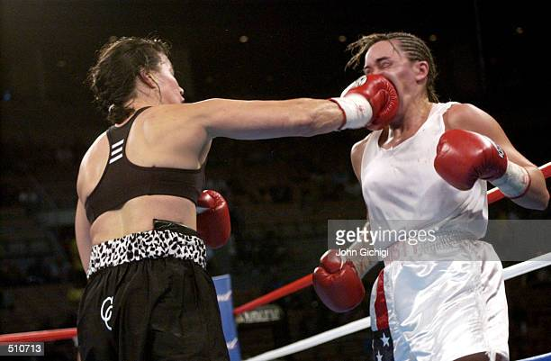 Lisa Holewyne lands a powerful punch into the face of Christy Martin during the women's pound for pound championship fight at the Mandalay Bay Resort...