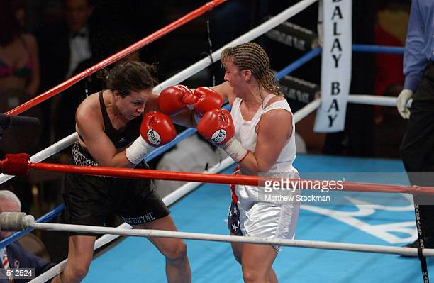 Lisa Holewyne struggles against Christy Martin during the women's pound for pound championship fight at the Mandalay Bay Resort Casino in Las Vegas...
