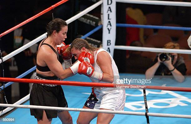 Lisa Holewyne throws a right hook against Christy Martin during the women's pound for pound championship fight at the Mandalay Bay Resort Casino in...