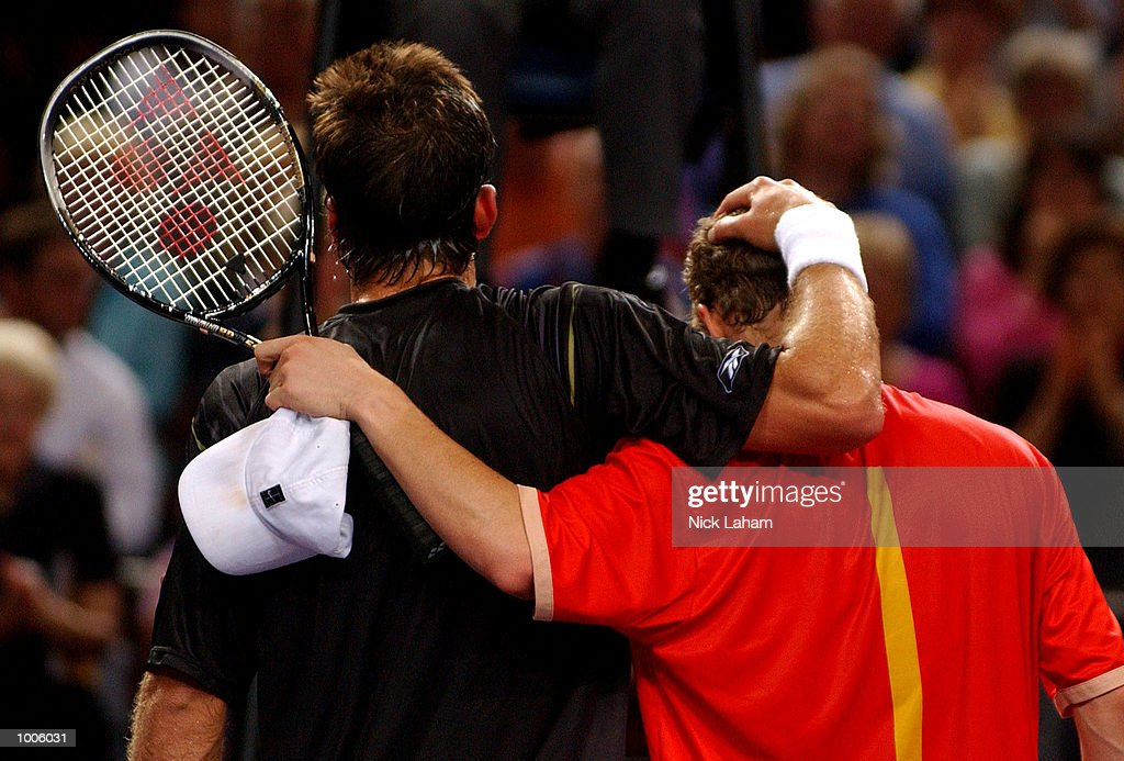 Lleyton Hewitt of Australia and Patrick Rafter of Australia leave the court after Hewitt's victory during the Tennis Masters Cup held at the Sydney Superdome, Sydney, Australia. DIGITAL IMAGE Mandatory Credit: Nick Laham/ALLSPORT