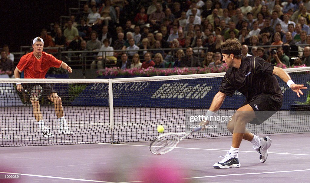Lleyton Hewitt of Australia and Patrick Rafter of Australia in action during pool play of the Tennis Masters Cup held at the Sydney Superdome in Sydney, Australia. DIGITAL IMAGE. Mandatory Credit: Scott Barbour/ALLSPORT