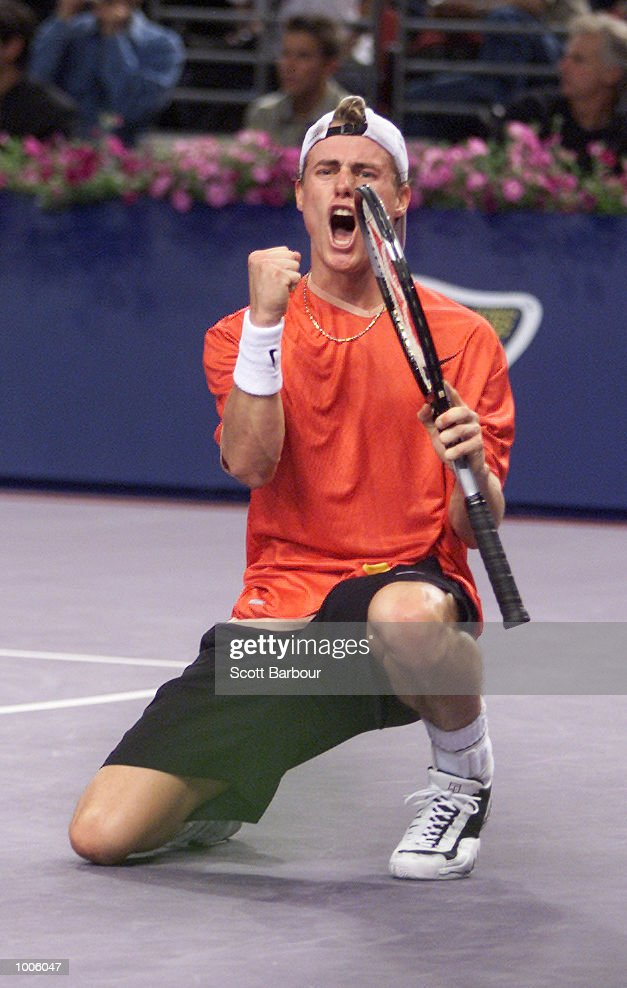 Lleyton Hewitt of Australia celebrates after defeating Patrick Rafter of Australia to become the new number one ranked player during pool play of the Tennis Masters Cup held at the Sydney Superdome in Sydney, Australia. DIGITAL IMAGE. Mandatory Credit: Scott Barbour/ALLSPORT