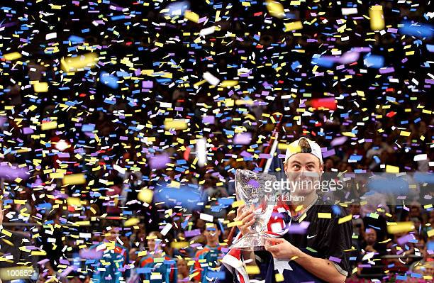 Lleyton Hewitt of Australia celebrates his victory over Sabastien Grosjean of France with the Championship trophy after the Final of the Tennis...