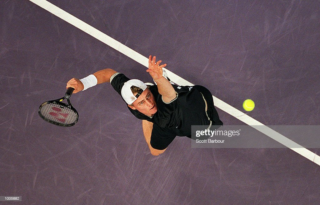 Lleyton Hewitt of Australia in action during his match against Andre Agassi of USA during day three of the Tennis Masters Cup held at the Sydney Superdome in Sydney, Australia. Mandatory Credit: Scott Barbour/ALLSPORT