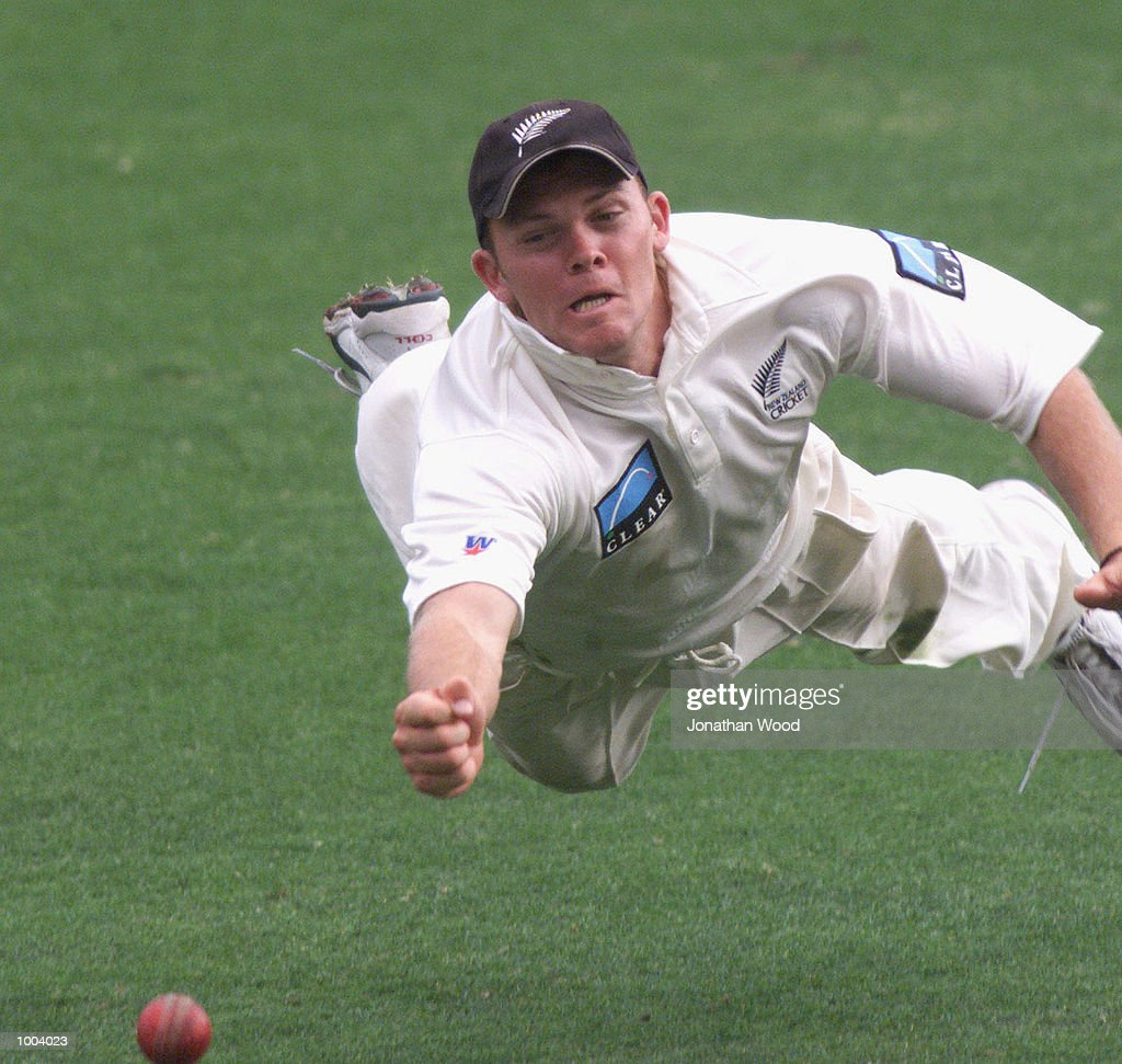 Lou Vincent of New Zealand dives for the ball during the third day of play between New Zealand and the Queensland Bulls at the Gabba, Brisbane, Australia. DIGITAL IMAGE. Mandatory Credit: Jonathan Wood/ALLSPORT