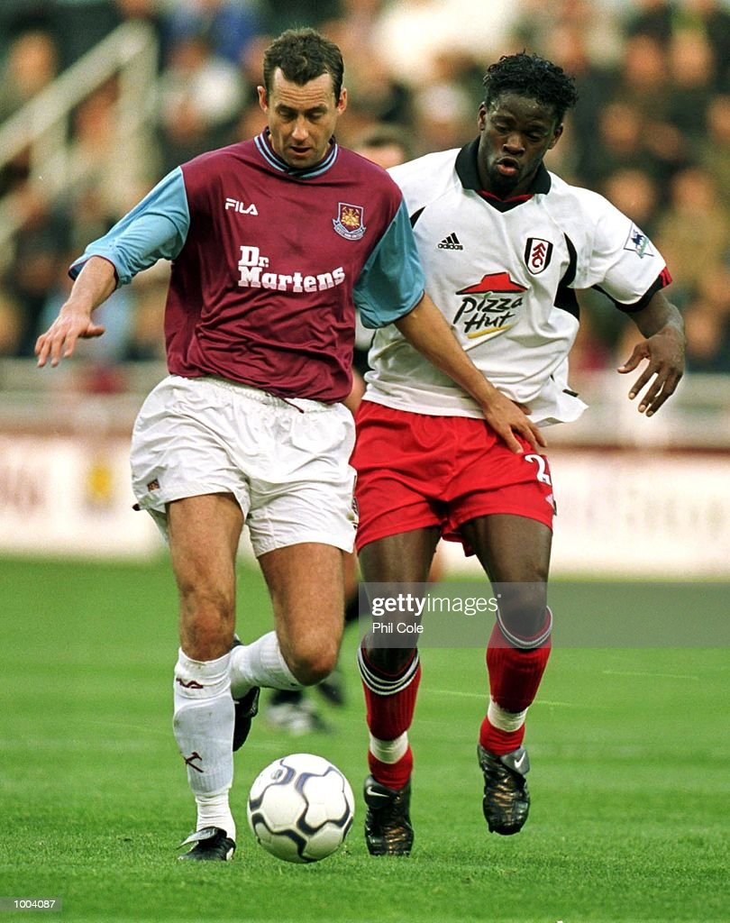 Louis Saha of Fulham tries to tackle Don Hutchison of West Ham United during the FA Barclaycard Premiership match between West Ham United and Fulham at Upton Park, London. Mandatory Credit: Phil Cole/ALLSPORT