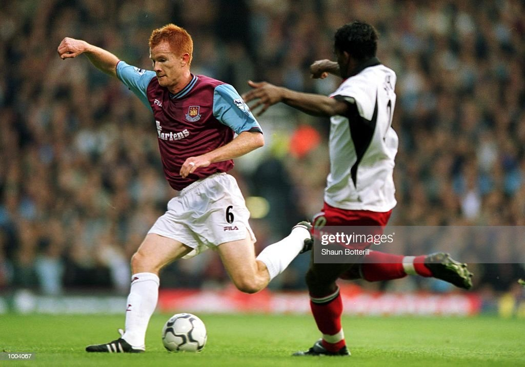 Louis Saha of Fulham tries to tackle Hayden Foxe of West Ham during the FA Barclaycard Premiership match between West Ham United and Fulham at Upton Park, London. Mandatory Credit: Shaun Botterill/ALLSPORT
