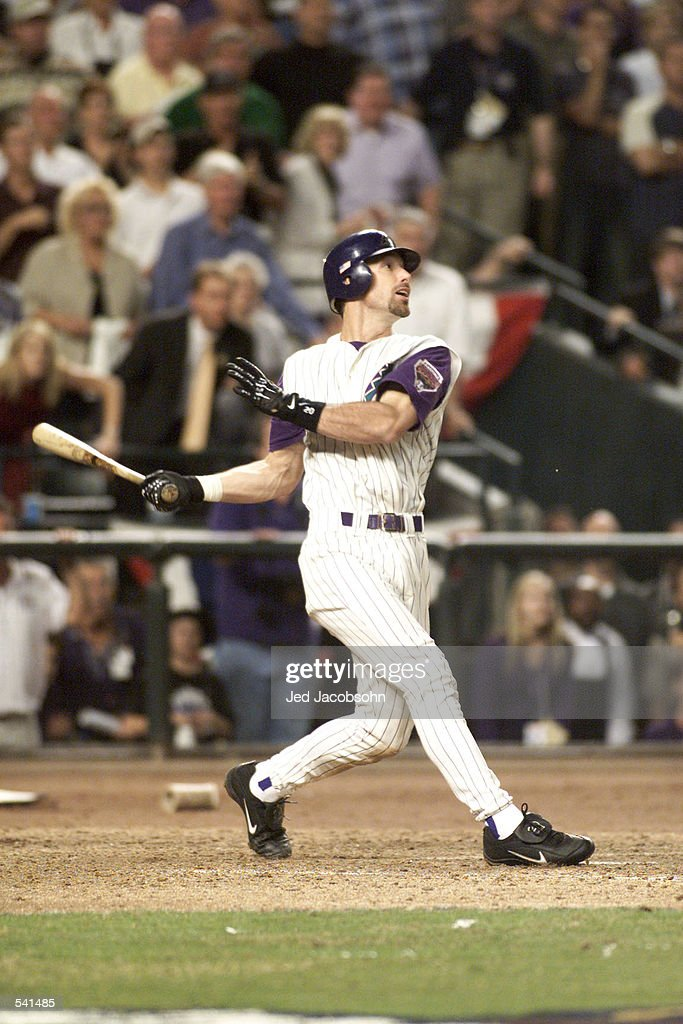 Luis Gonzalez of the Arizona Diamondbacks hits the winning run against the New York Yankees in the ninth inning of game 7 of the World Series at Bank...