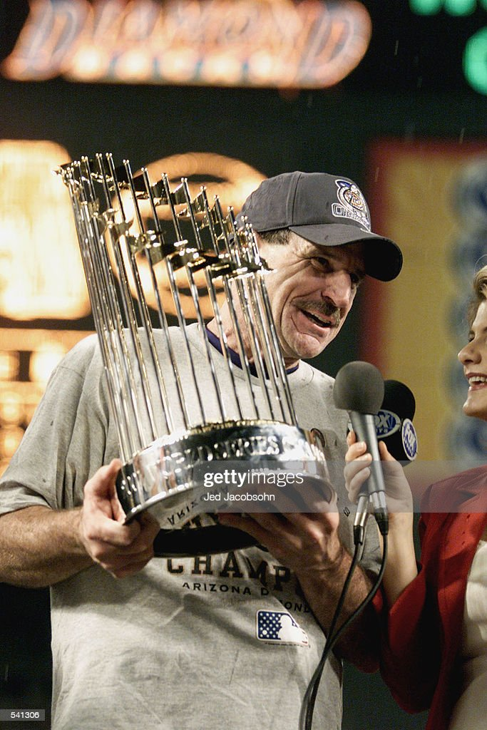 Manager Bob Brenly #15 of the Arizona Diamondbacks holds the trophy after the team won the World Series over the New York Yankees at Bank One Ballpark in Phoenix, Arizona. The Diamondbacks defeated the Yankees 3-2. DIGITAL IMAGE Mandatory Credit: Jed Jacobsohn/ALLSPORT