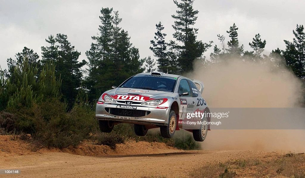 Marcus Gronholm and co-driver Timo Rautiainen put their Peugeot 206 WRC over a jump in the 4.19 km outback bush tracks around the Sotico Special Stage of the Telstra Rally Australia at Perth, Australia. DIGITAL IMAGE Mandatory Credit: Tony McDonough/ALLSPORT