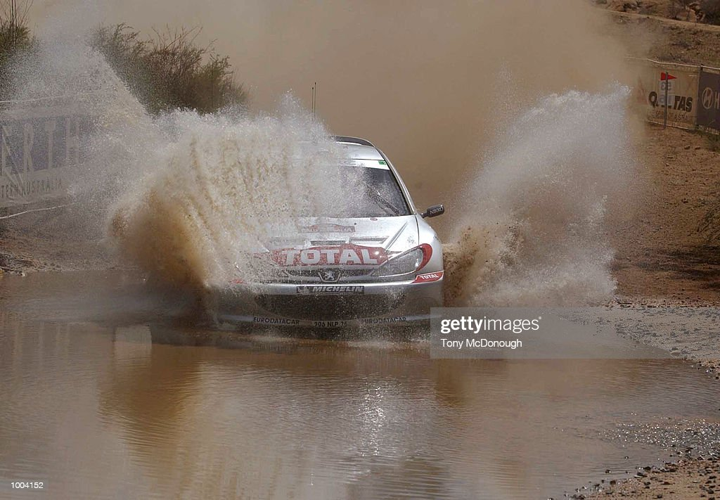 Marcus Gronholm and co-driver,Timo Rautiainen put their Peugeot 206 WRC through the water jump in the 4.19 km outback bush tracks around the Sotico Special Stage to take 1st position of the Telstra Rally Australia at Perth, Australia.DIGITAL IMAGE Mandatory Credit: Tony McDonough/ALLSPORT