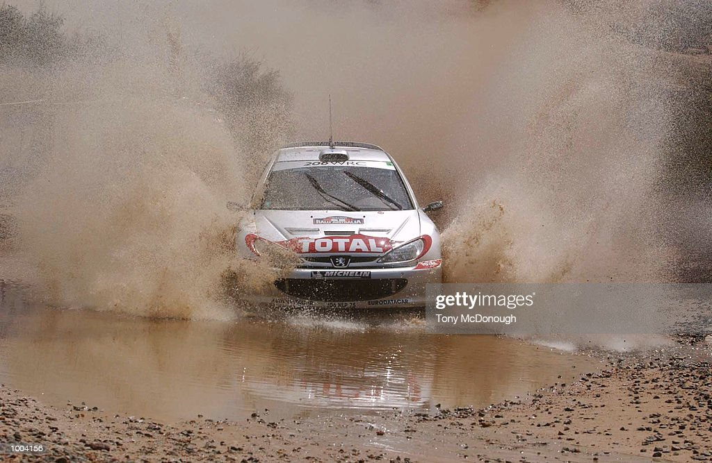 Marcus Gronholm and co-driver,Timo Rautiainen put their Peugeot 206 WRC through the water jump in the 4.19 km outback bush tracks around the Sotico Special Stage to take 1st position of the Telstra Rally Australia at Perth, Australia. DIGITAL IMAGE Mandatory Credit: Tony McDonough/ALLSPORT
