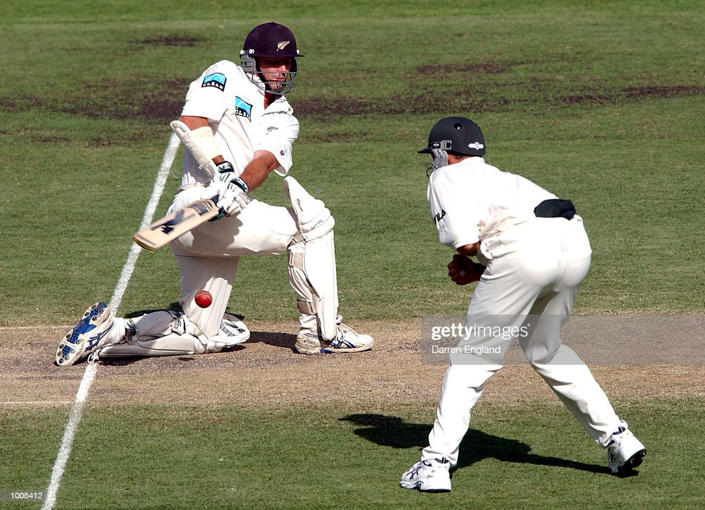 Mathew Sinclair of New Zealand play's a sweep shot past Matthew Hayden of Australia during day five of the first Cricket test between Australia and New Zealand played at the Gabba in Brisbane, Australia. DIGITAL IMAGE. Mandatory Credit: Darren England/ALLSPORT