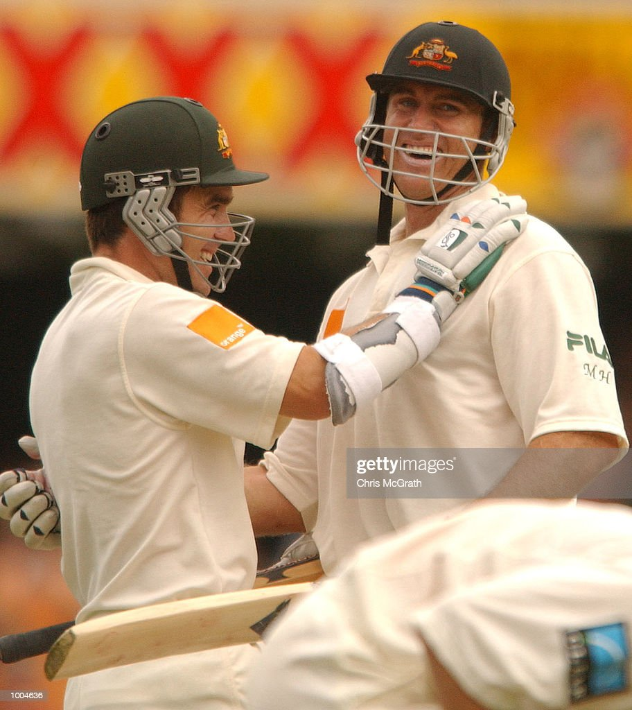 Matthew Hayden is congratulated by team mate Justin Langer after scoring a century during day one of the first cricket test between Australia and New Zealand held at the Gabba, Brisbane, Australia, DIGITAL IMAGE Mandatory Credit: Chris McGrath/ALLSPORT