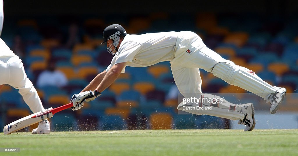 Matthew Hayden of Australia dives for the crease, but is run out for 13 runs against New Zealand during day five of the first Cricket test between Australia and New Zealand played at the Gabba in Brisbane, Australia. DIGITAL IMAGE. Mandatory Credit: Darren England/ALLSPORT