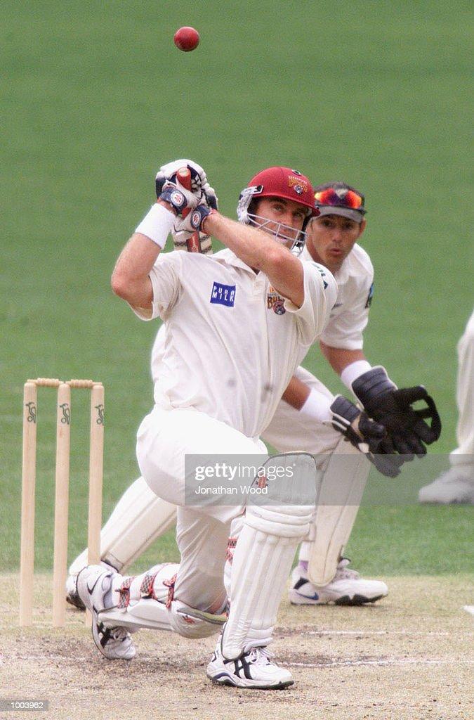 Matthew Hayden of Queensland blasts a six during the third day of play between New Zealand and the Queensland Bulls at the Gabba, Brisbane, Australia. DIGITAL IMAGE. Mandatory Credit: Jonathan Wood/ALLSPORT