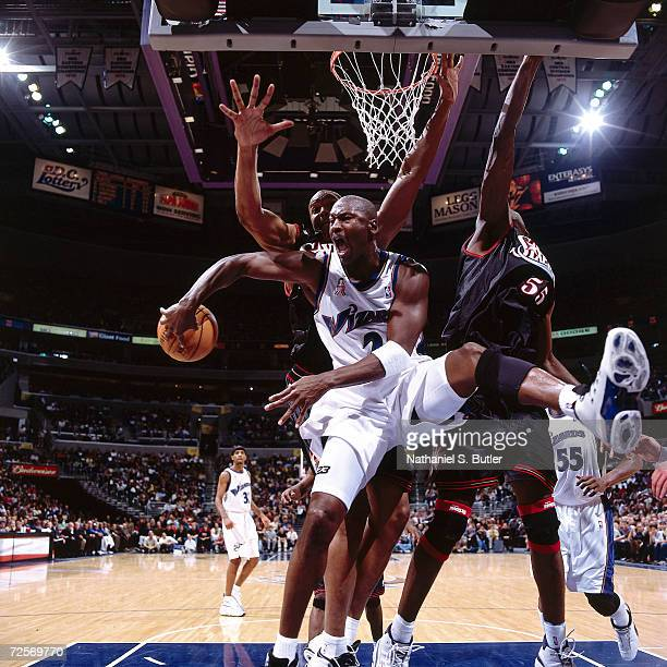 Michael Jordan of the Washington Wizards passes behind his back against the Philadelphia 76ers during the NBA game at the MCI Center in Washington...