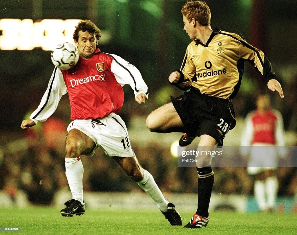 Michael Stewart of Manchester United and Gilles Grimandi of Arsenal in action during the Worthington Cup, Third Round match between Arsenal and Manchester United at Highbury, London. Mandatory Credit: Phil Cole/ALLSPORT