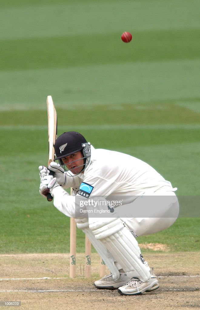 Nathan Astle of New Zealand ducks under a bouncer bowled by Glenn McGrath of Australia during day four of the first Cricket test between Australia and New Zealand played at the Gabba in Brisbane, Australia. DIGITAL IMAGE. Mandatory Credit:Darren England/ALLSPORT