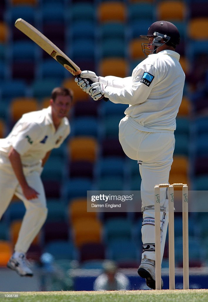 Nathan Astle of New Zealand hits four runs off the bowling of Michael Kasprowicz of Queensland during the New Zealand cricket teams tour match against Queensland played at the Gabba in Brisbane, Australia. DIGITAL IMAGE. Mandatory Credit: Darren England/ALLSPORT