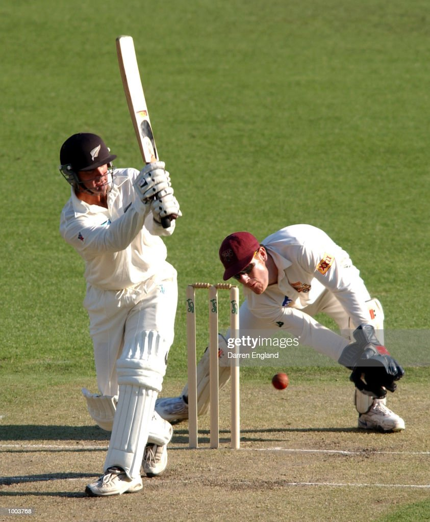 Nathan Astle of New Zealand in action while Wade Seccombe of Queensland looks on during the New Zealand cricket teams tour match against Queensland played at the Gabba in Brisbane, Australia. DIGITAL IMAGE. Mandatory Credit: Darren England/ALLSPORT