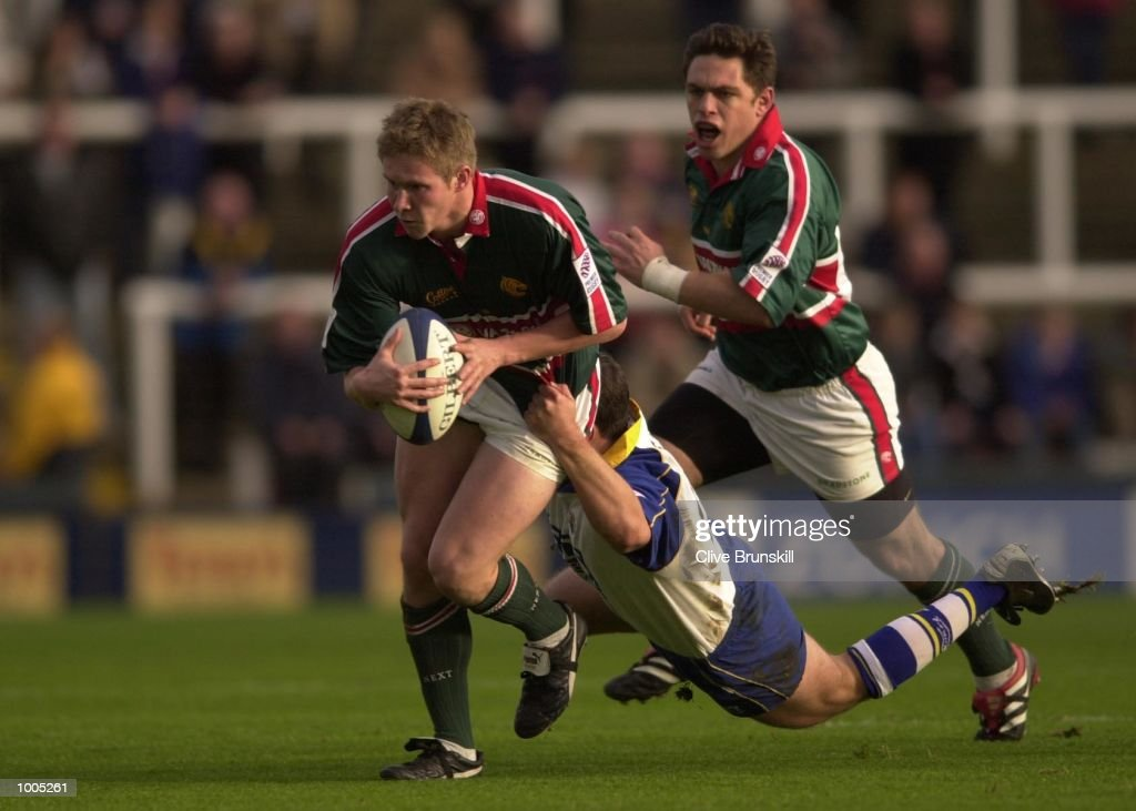 Olly Smith of Leicester is tackled by Tristan Davies of Leeds in the Zurich Premiership match between Leeds Tykes and Leicester Tigers at Headingley, Leeds. DIGITAL IMAGE. Mandatory Credit: Clive Brunskill/ALLSPORT