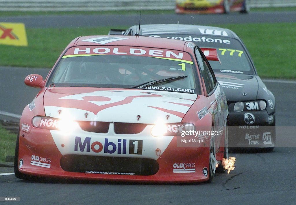 Overall championship winner Mark Skaife #1 in his Commodore VX races with the headlights on during the first race of Round 12 Shell Championship at Pukekohe Park Raceway, south of Auckland, New Zealand. Mark Larkham was awarded the race ahead of Greg Murphy after a red flag decision which took the race back a lap to give Larkham the win, but Skaife's 4th place was enought to give him the title. Mandatory Credit: Nigel Marple/ALLSPORT
