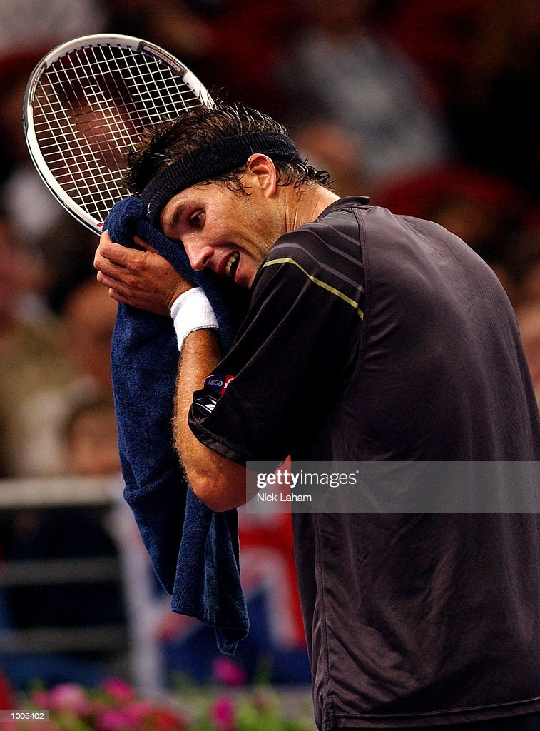 Patrick Rafter of Australia wipes his face during his match against Andre Agassi of the United States during the Tennis Masters Cup held at the Sydney Superdome, Sydney, Australia. DIGITAL IMAGE Mandatory Credit: Nick Laham/ALLSPORT