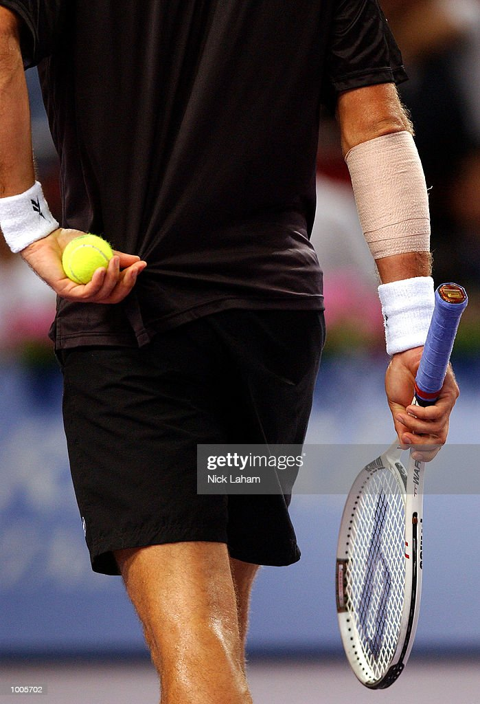 Patrick Rafter of Australia with his arm strapped after treatment during his match against Sabastien Grosjean of France during the Tennis Masters Cup held at the Sydney Superdome, Sydney, Australia. DIGITAL IMAGE Mandatory Credit: Nick Laham/ALLSPORT