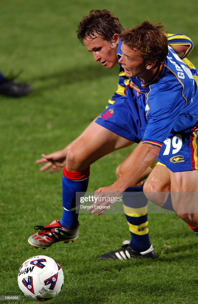 Paul Foster #9 of the Strikers tries to tackle Ryan Griffiths #19 of the Spirit during the NSL round 5 match between the Brisbane Strikers and the Northern Spirit played at Ballymore in Brisbane, Australia. DIGITAL IMAGE. Mandatory Credit:Darren England/ALLSPORT