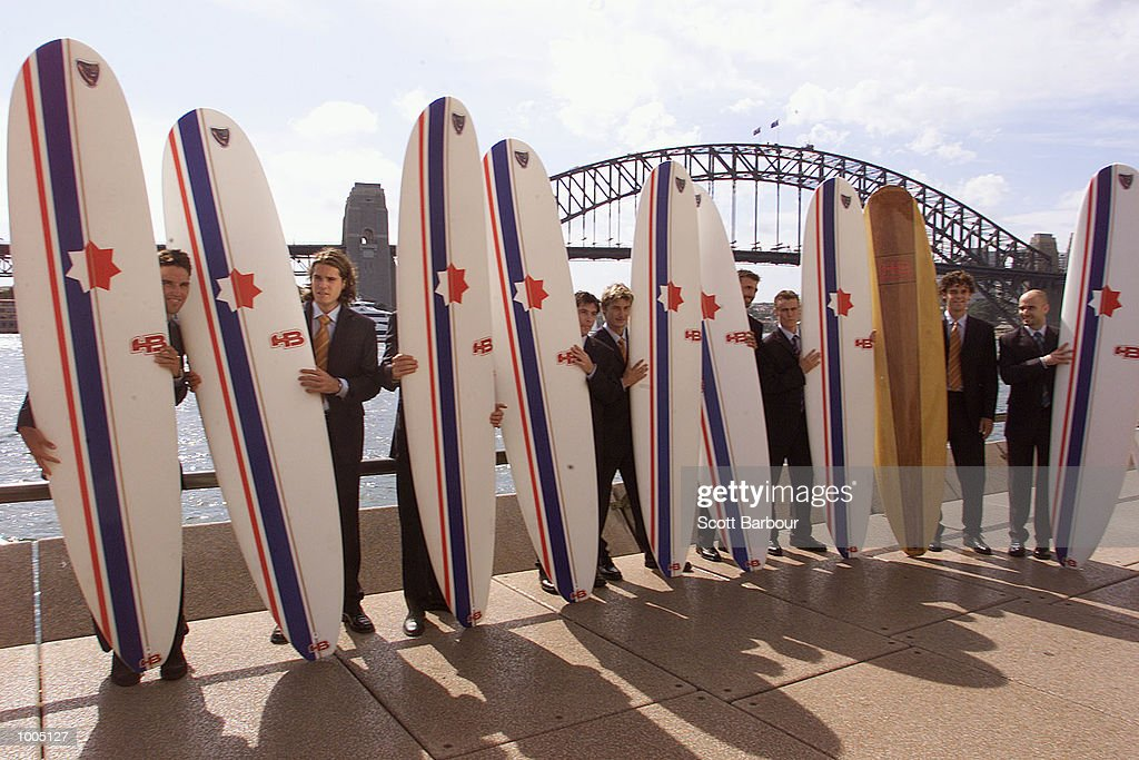 Players pose in front of the Sydney Harbour bridge with surfboards (L to R) Patrick Rafter of Australia, Tommy Hass of Germany, Yevgeny Kafelnikov of Russia, Sebastien Grosjean of France, Juan Carlos Ferrero of Spain, Goran Ivanisevic of Croatia, Lleyton Hewitt of Australia, Gustavo Kuerten of Brazil and Andre Agassi of USA before a media conference in preparation for the Tennis Masters Cup in Sydney, Australia. DIGITAL IMAGE. Mandatory Credit: Scott Barbour/ALLSPORT