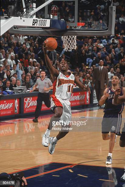 Point guard Mookie Blaylock of the Golden State Warriors shoots a layup during the NBA game against the New Jersey Nets at the Arena in Oakland in...