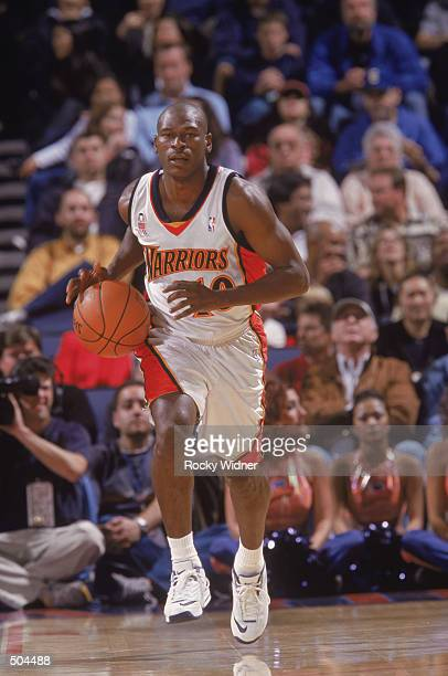 Point guard Mookie Blaylock of the Golden State Warriors dribbles the ball during the NBA game against the New Jersey Nets at the Arena in Oakland in...